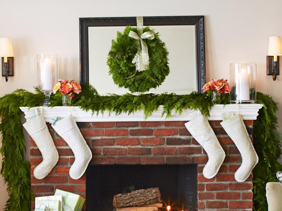 mantels mantles evergreens pine cones berries branches color theme ribbon bow