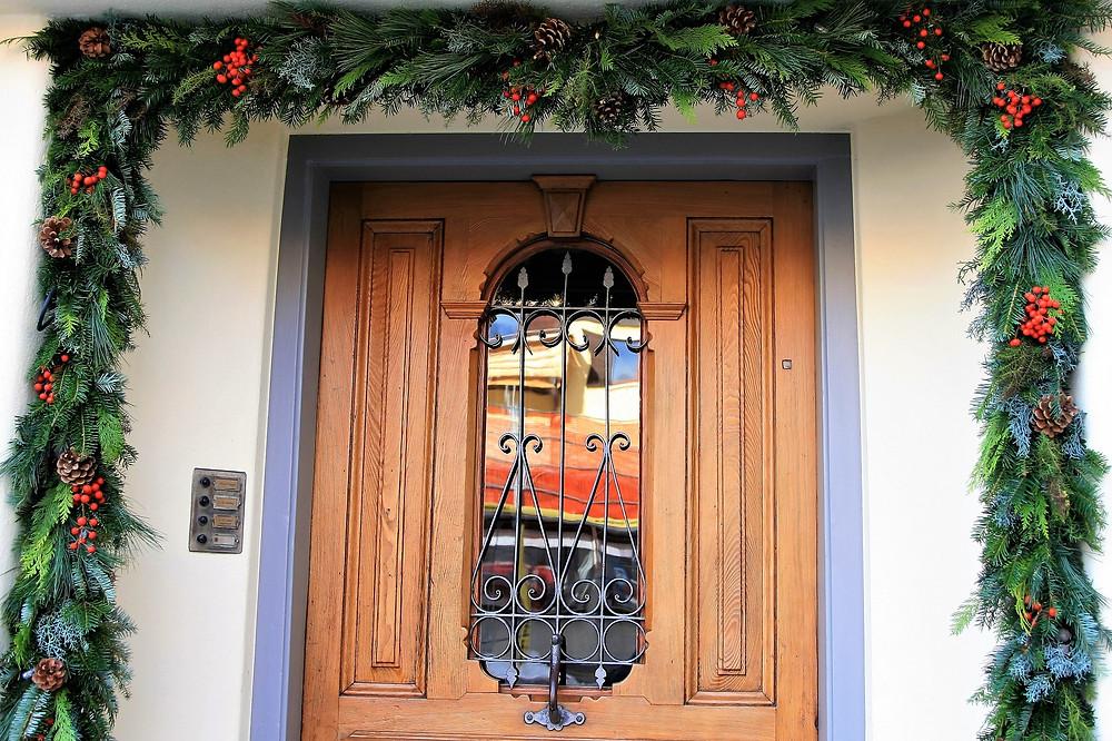 door garland frame entryway Christmas