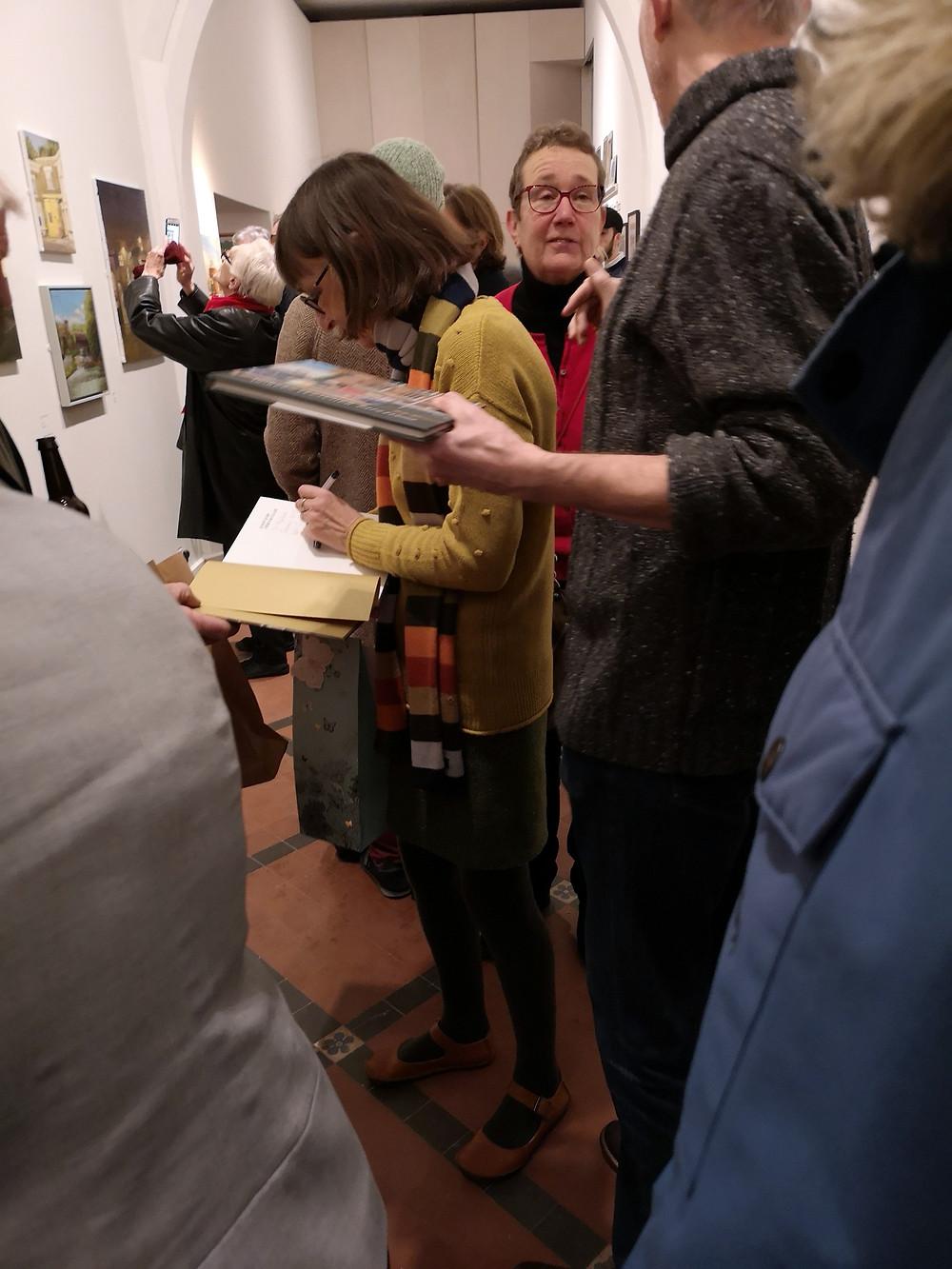 Doreen signing copies of her book