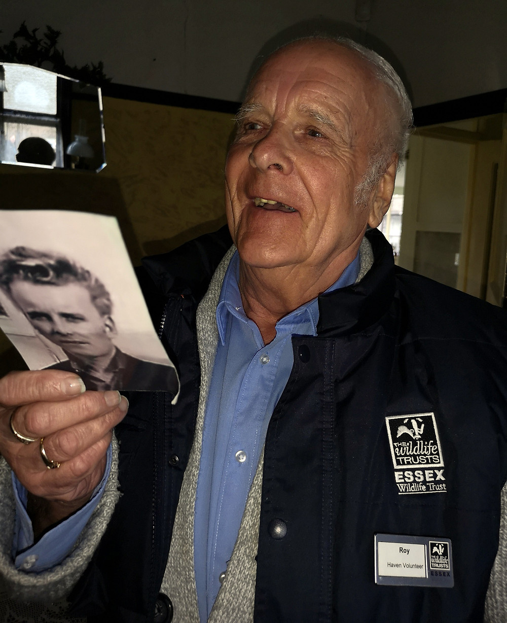 Roy with a picture of his younger self