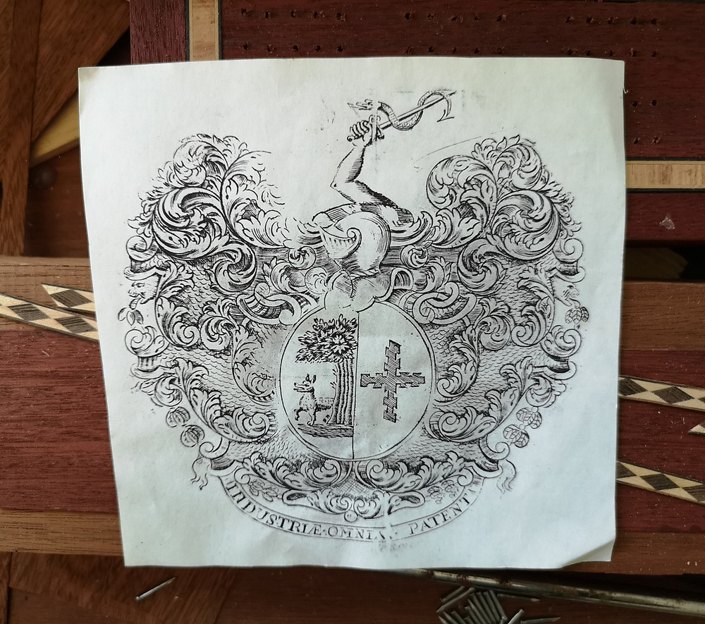 A print from a coat of arms engraved by Peter (below).