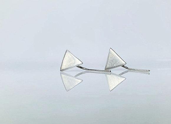 Arete minimalista triangulo pasante