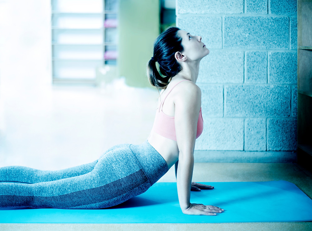Woman Practising Yoga in Garage
