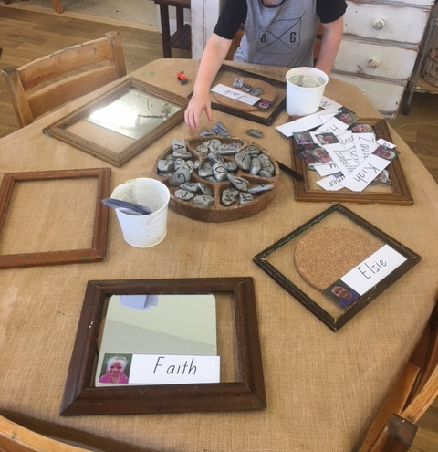 recycled frames from op shops and pebbles used in our literacy experiences