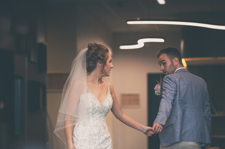 Bride and Groom passing in the hotel lobby in The Mecure Centre Hotel Bedford.