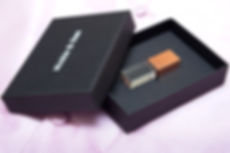 The Essential Collection crystal USB in a black presentation box.