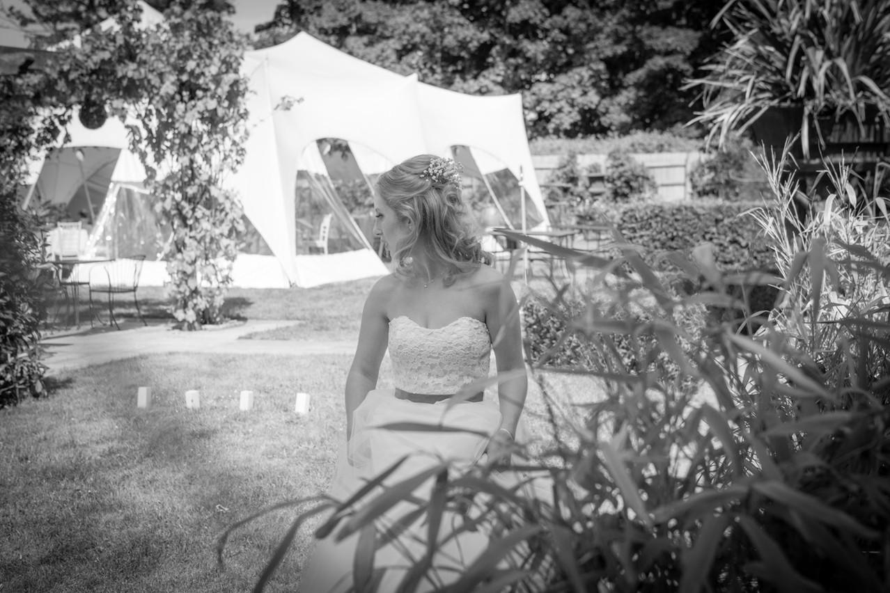 Bride in the gardens looking over her shoulder.