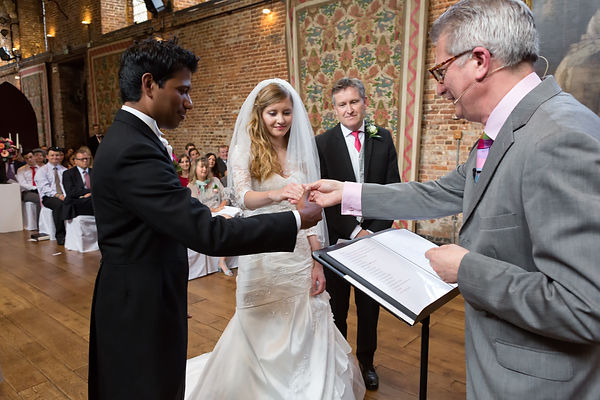Couple getting married in the Old Palace at Hatfield House UK.
