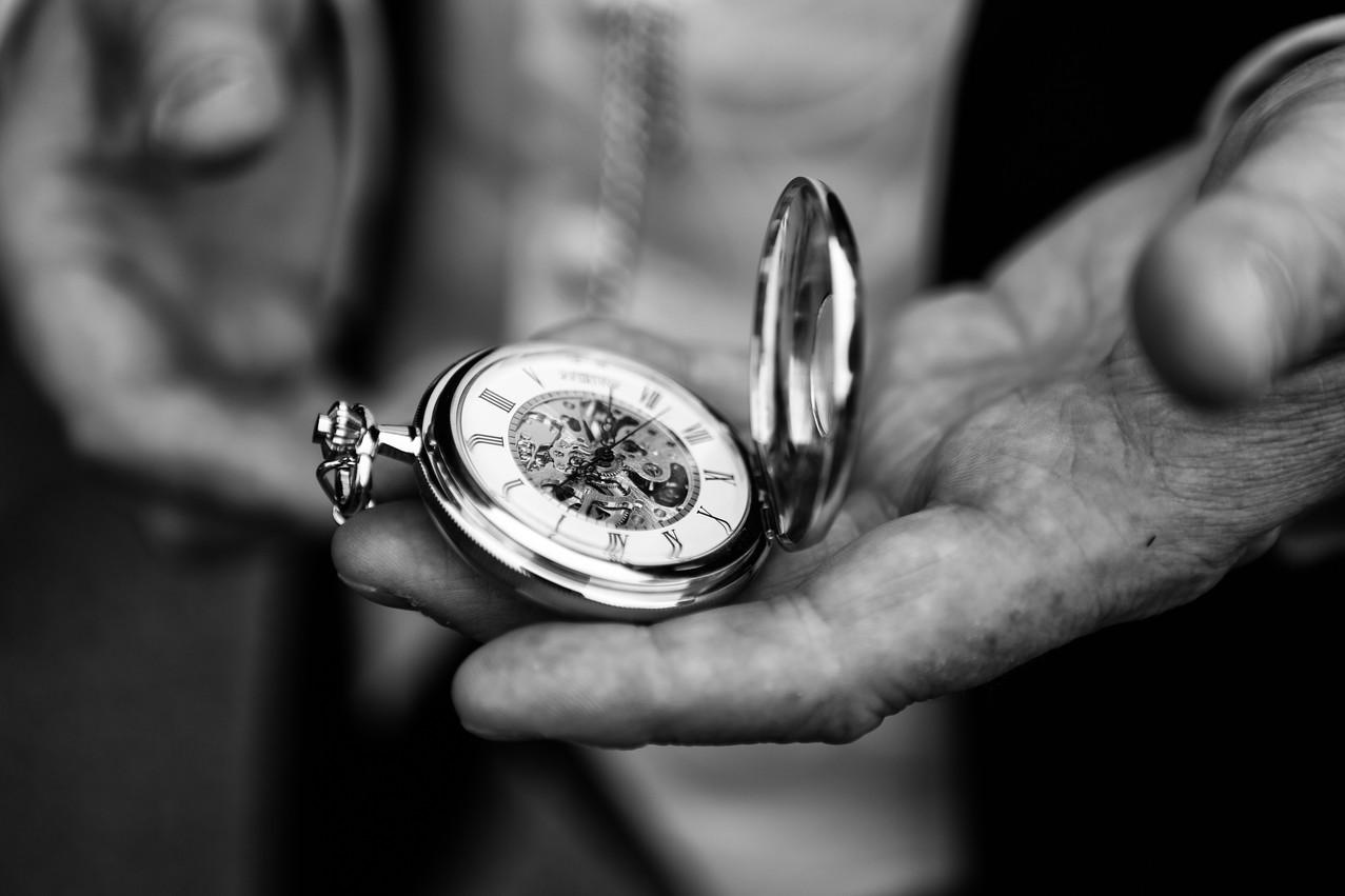 Groom looking at his pocket watch.