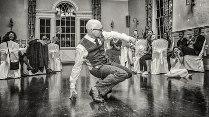 Groom dancing on the dance floor.