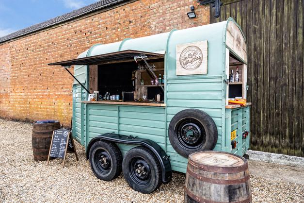 Horse box mobile bar serving cocktails at Eastfields Farm Barns, Bedfordshire, UK.