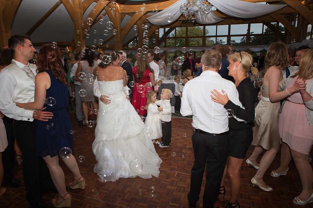Wedding party dancing with bubbles.