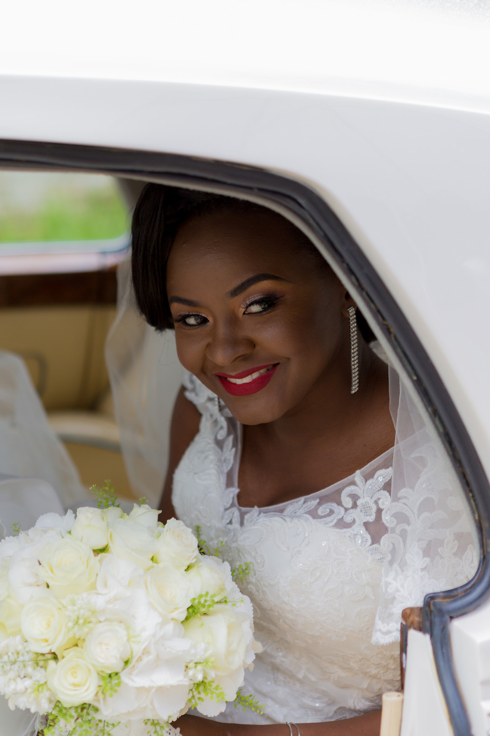 Beautiful Bride in her wedding day car arriving at the church.