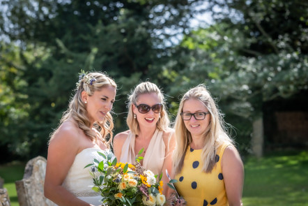 Bride and friends with her bouque