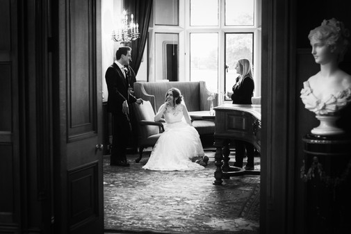 Bride and Groom pictured talking in a Manor House.
