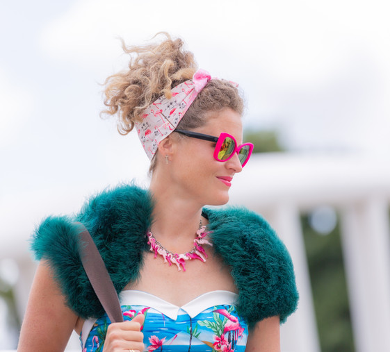 Lady dressed in a flamingo theme.