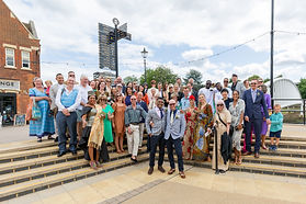 Wedding day group shot by the river Great Ouse in Bedford, Bedfordshire.