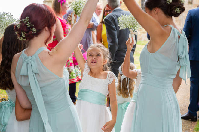 Bridemaids having fun with their arms in the air.