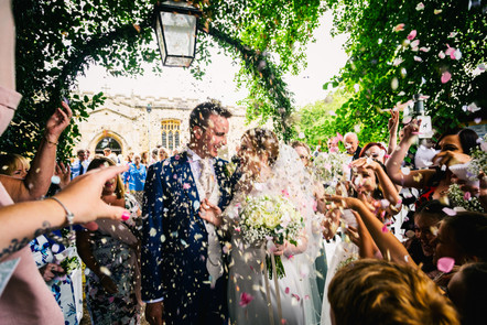 Bride and Groom surrounded by confetti throwers.