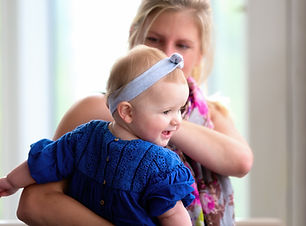 Young baby girl in her mothers arms at her Brithday party at the Park Inn Bedford.