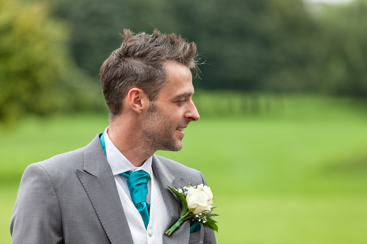 Groom with button hole.