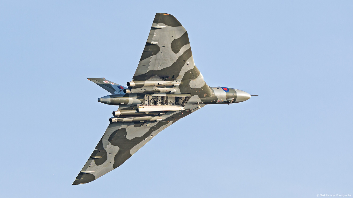 Vulcan Bomber with bomb doors open in flight over Shuttleworth UK.