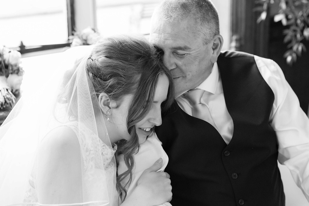 Proud loving father with his daughter on her wedding day.