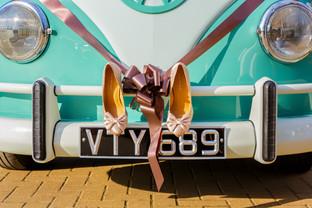VW camper van and wedding shoes.