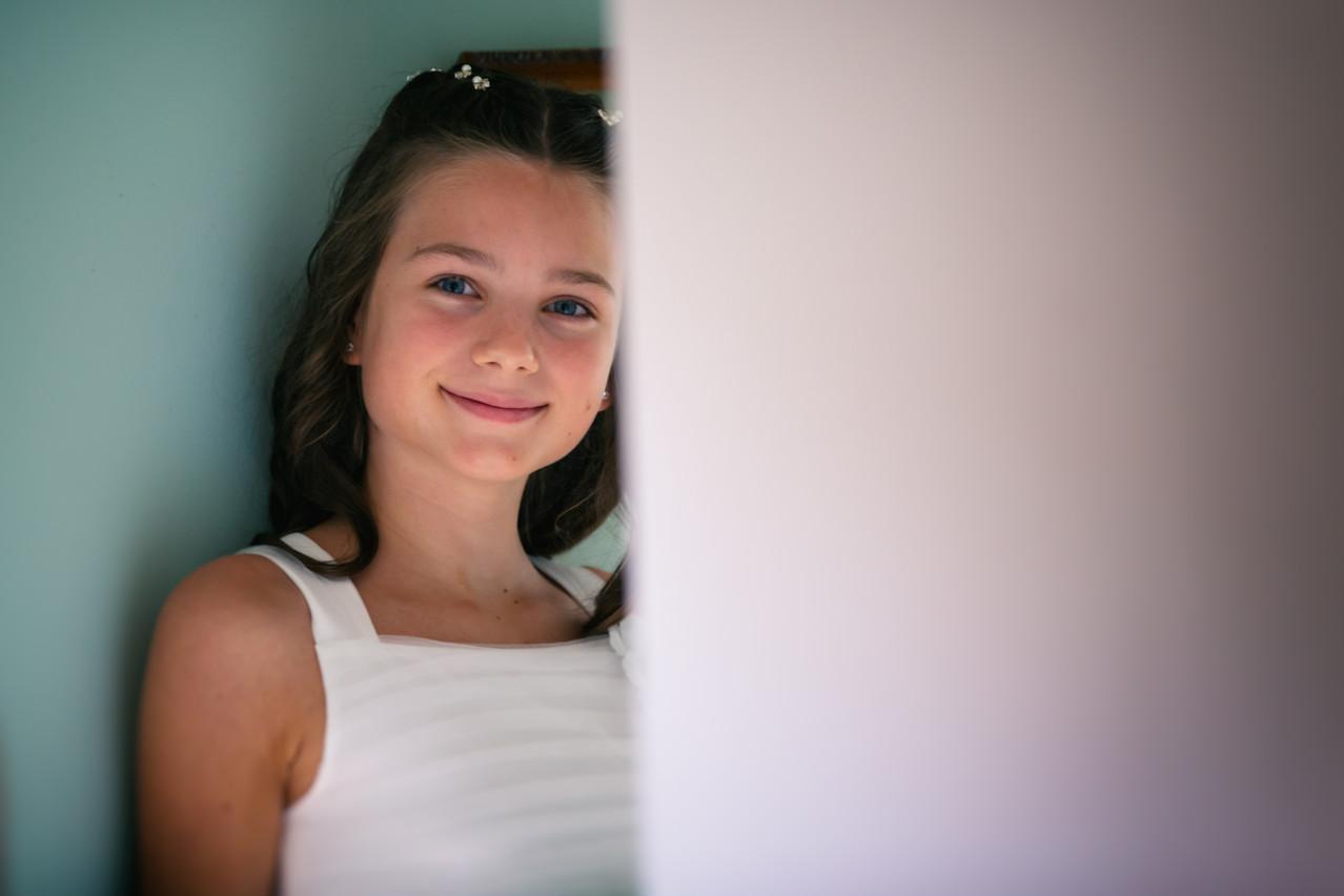 Girl smiling at the camera.