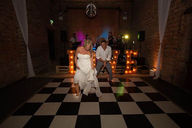 The first dane in a barn with the bride dancing a solo spot.