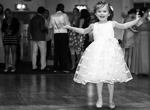Young flower girl leading the way on the dance floor.