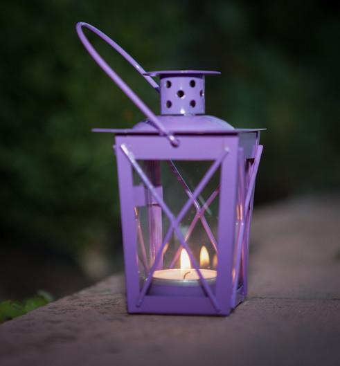 Candle lite purple lantern at night.