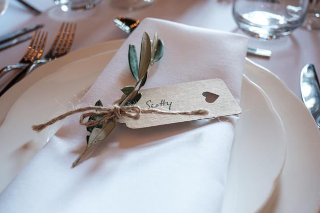 Napkin with a simple flower arrangement.