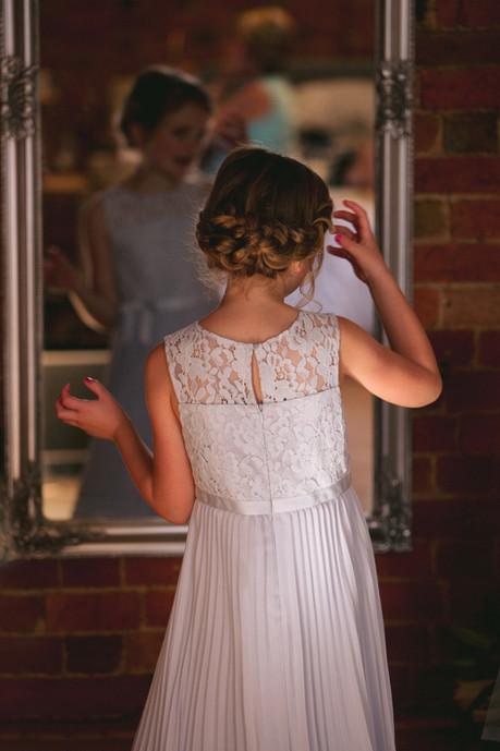 Flower girl looking in the mirror.