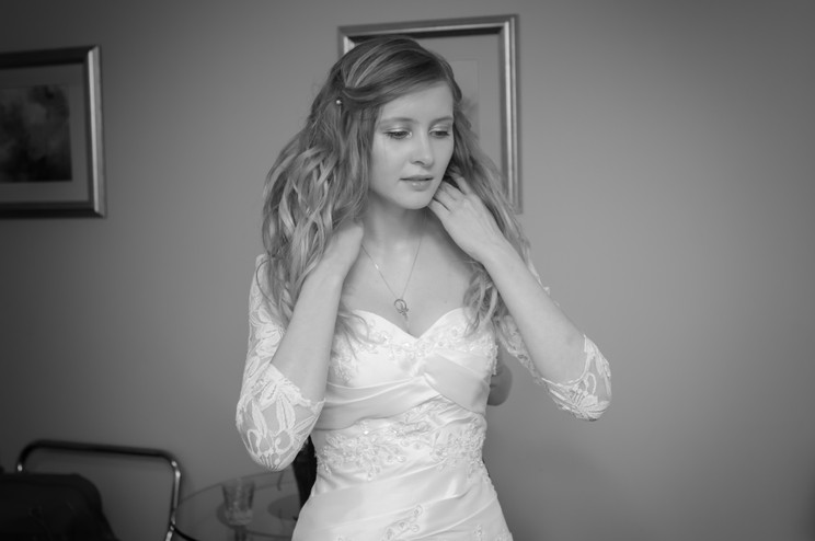 Bride with long cascading hair in her wedding dress.
