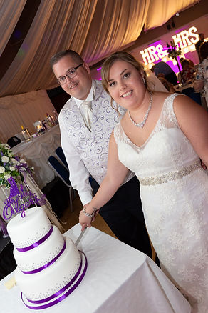 Bride and Groom cutting the Wedding Day cake.