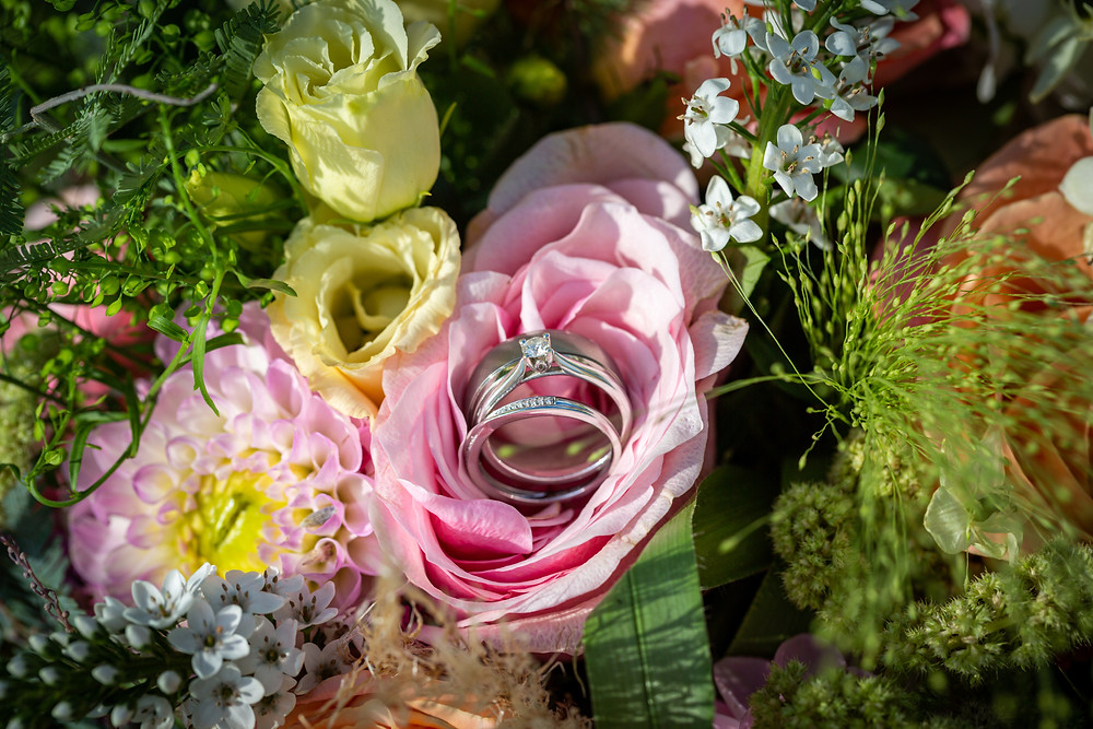 Wedding rings on the Brides bouquet