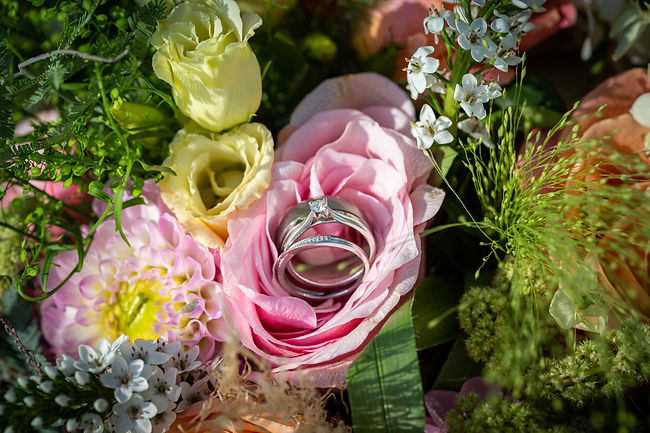 Wedding and Engagement rings on the Brides bouquet shot using a macro lens.