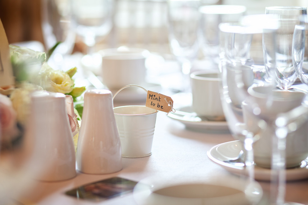 Wedding breakfast table with mint to be bucket.