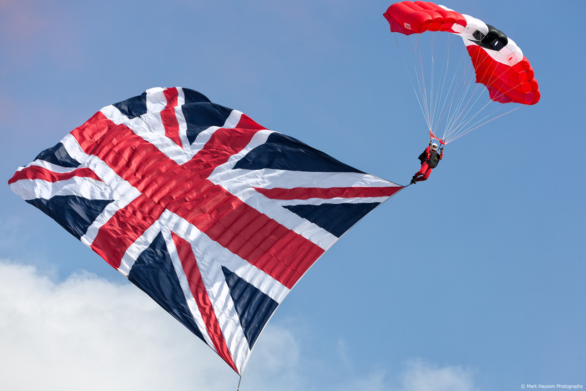 Parachute jumping with Union Jack Flag.