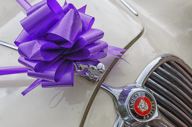 Jaguar 2.4 Ltr wedding day car with ribbons.