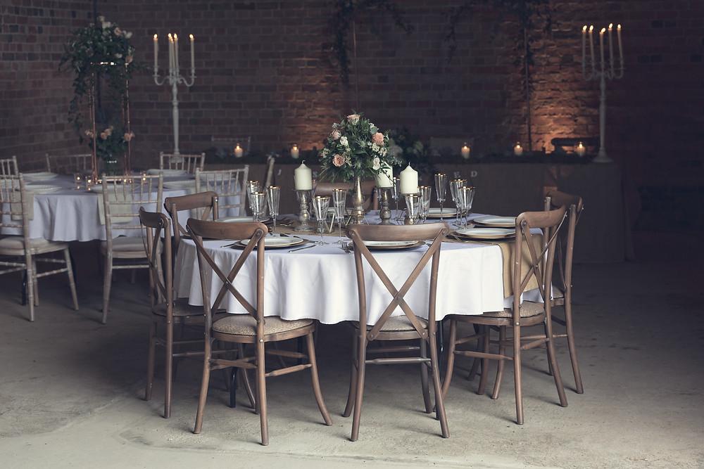 Vintage wedding breakfast table look in a barn.