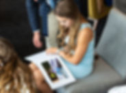 Young lady sat down looking at a weddng day signing book.