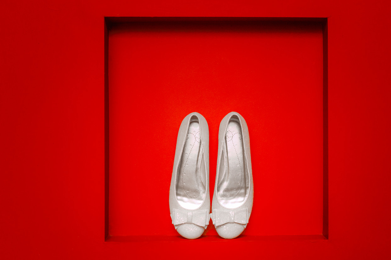 Wedding flats in a red picture frame