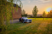 Morgan sports car pictured as the sun sets over the valley.