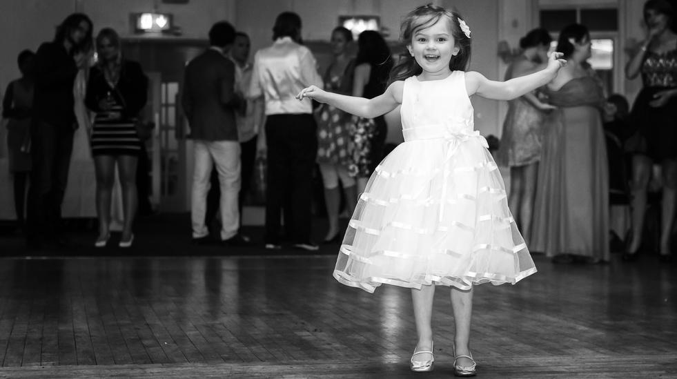 Flower girl dancing allown on the dance floor.