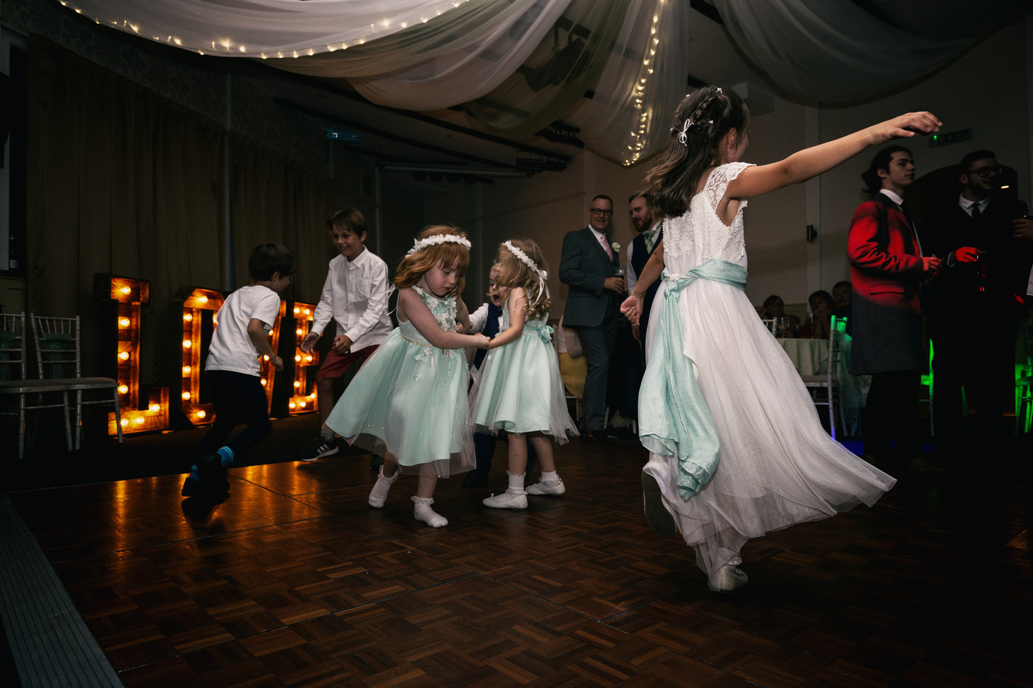 Flower girl daning on the dance floor with a vintage look.