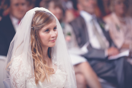 Bride during the wedding service at The Old Palace Hatfield House, UK