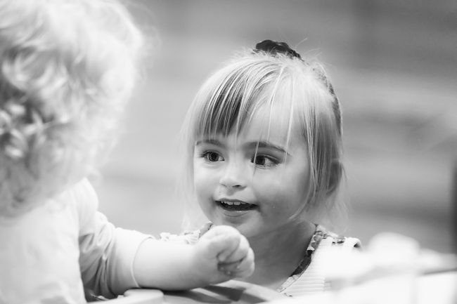 Two young children meeting for the first time at a Wedding Breakfast.