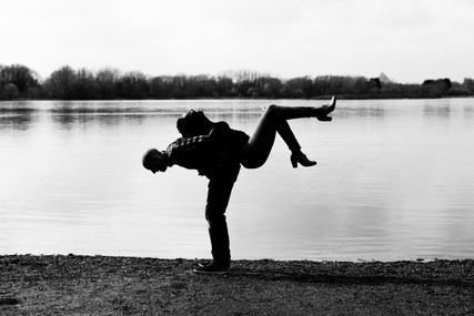 Engagement couple pictured in silhouette at the Priory Marina in Bedford, UK